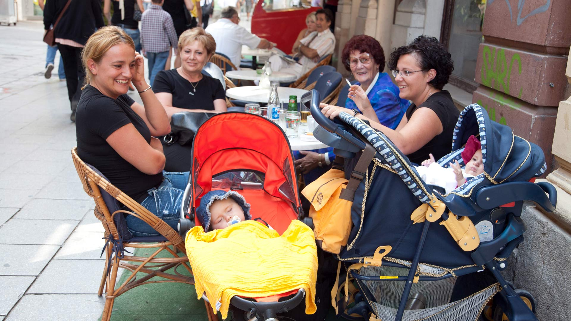 Women and babies in an outdoor café