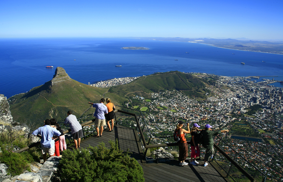 Tourists enjoying breathtaking views of Cape Town from top of Table mountain