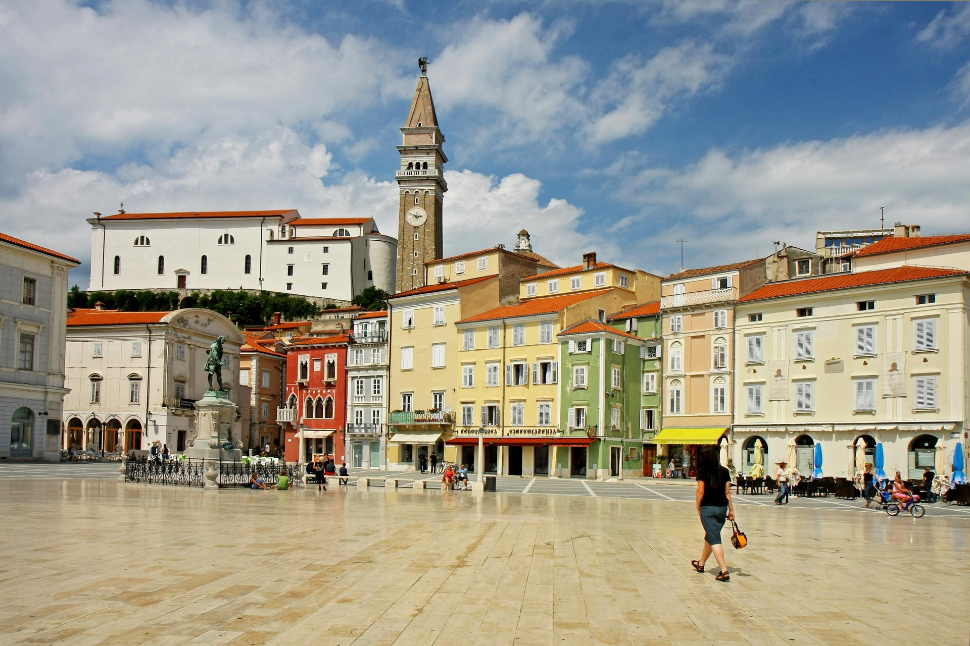 Tartini Square and Statue of Giuseppe Tartini overlooked by the venetian belfry of Saint George cathedral, Piran, Slovenia