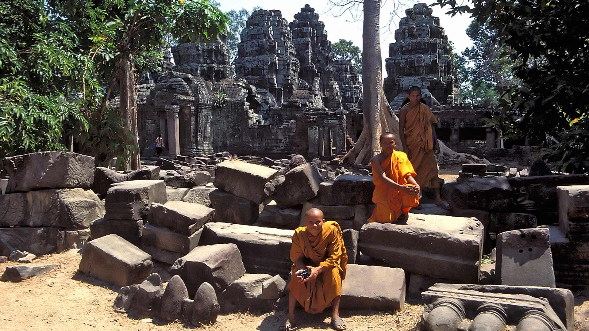 Buddhist monks in the courtyard of Banteay Kdei, Angkor, Siem Reap, Cambodia