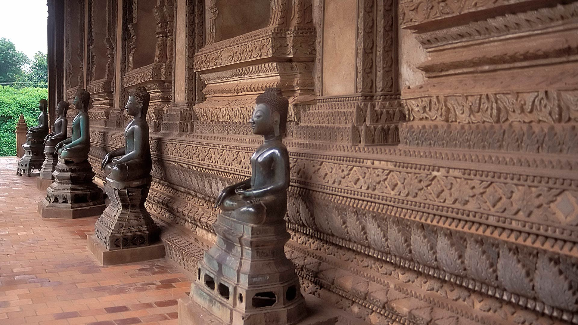 Sculptures of the terrace of the Wat Pha Kaew, Vientiane, Laos