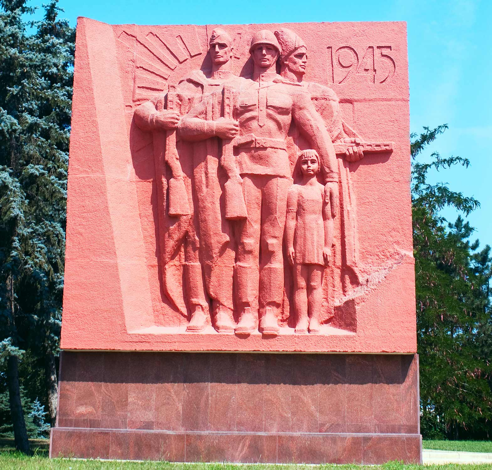World War II monument with Soviet soldiers and young girl with 1945 inscription with sky in Chisinau memorial complex