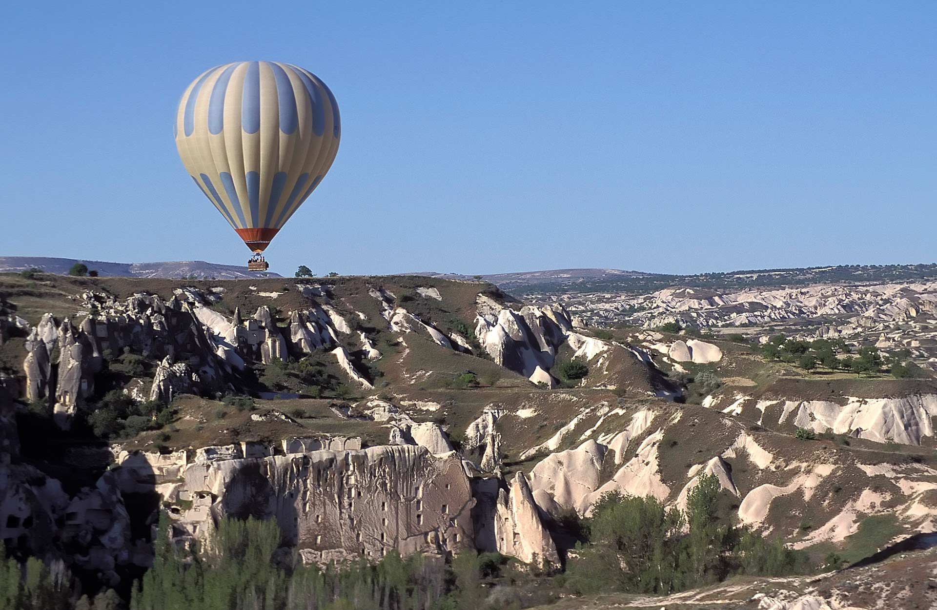 Aerial view of a hot air balloon flying over the Dovecote Valley, as seen from a hot air balloon, Cappadocia, Nevsehir, Turkey