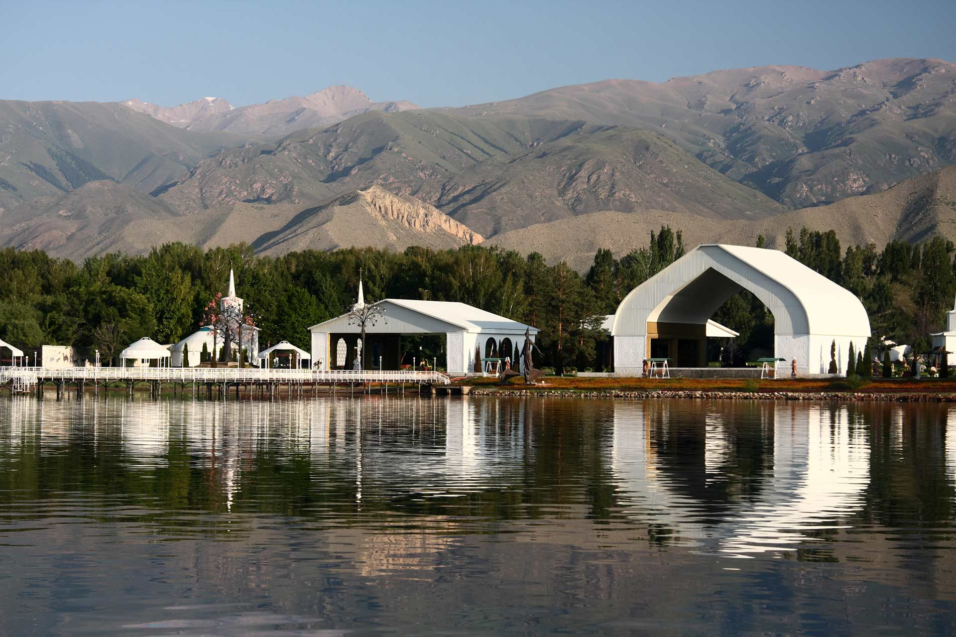 Architectural complex on the bank of mountain lake.Kyrgyzstan. Lake Issyk-kul.