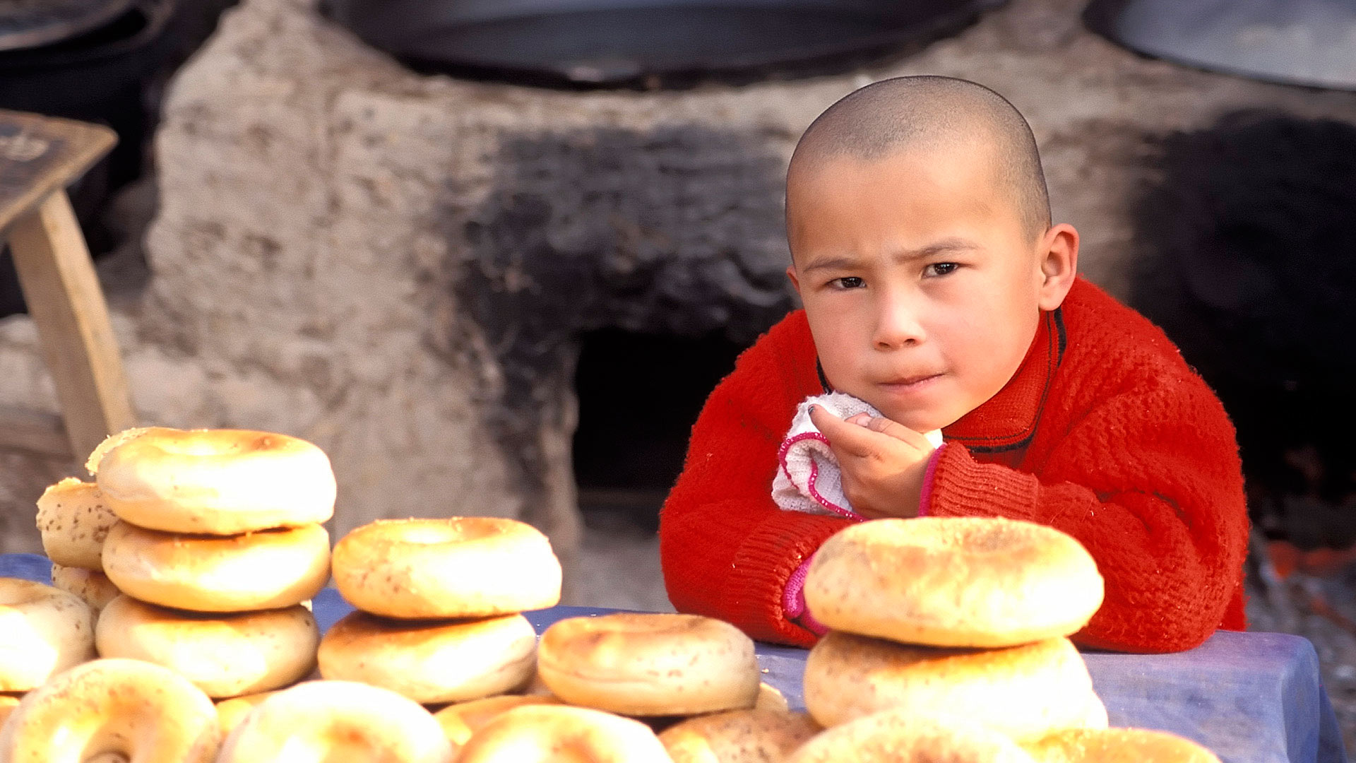 boy with baked bread at the Bazaar