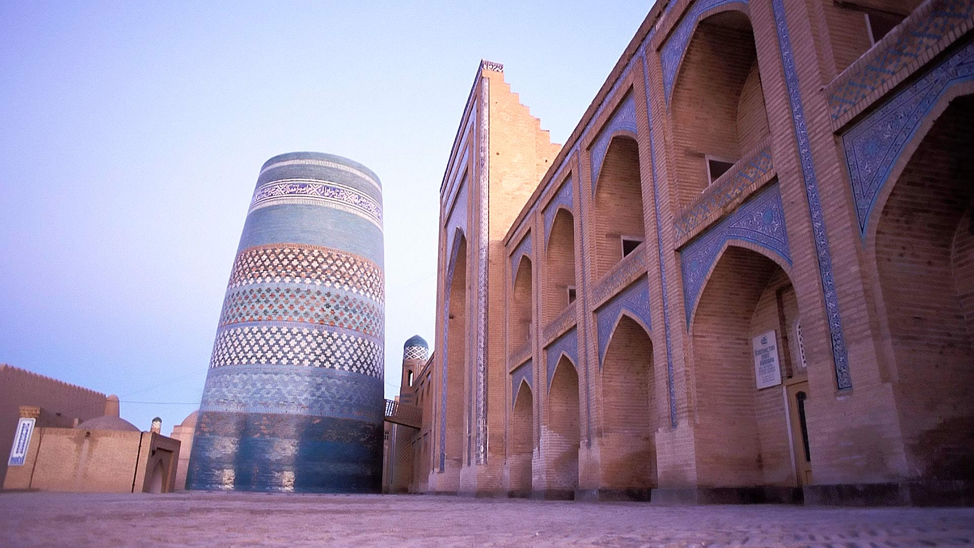 Kalta-Minor Minaret and Muhammad Amin Khan Medressa at dusk, Khiva, Khorezm, Uzbekistan