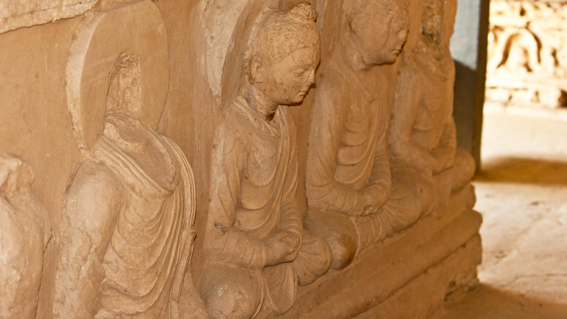 Seated Buddhas in a votive stupa in the lower stupa court of Jaulian, Taxila