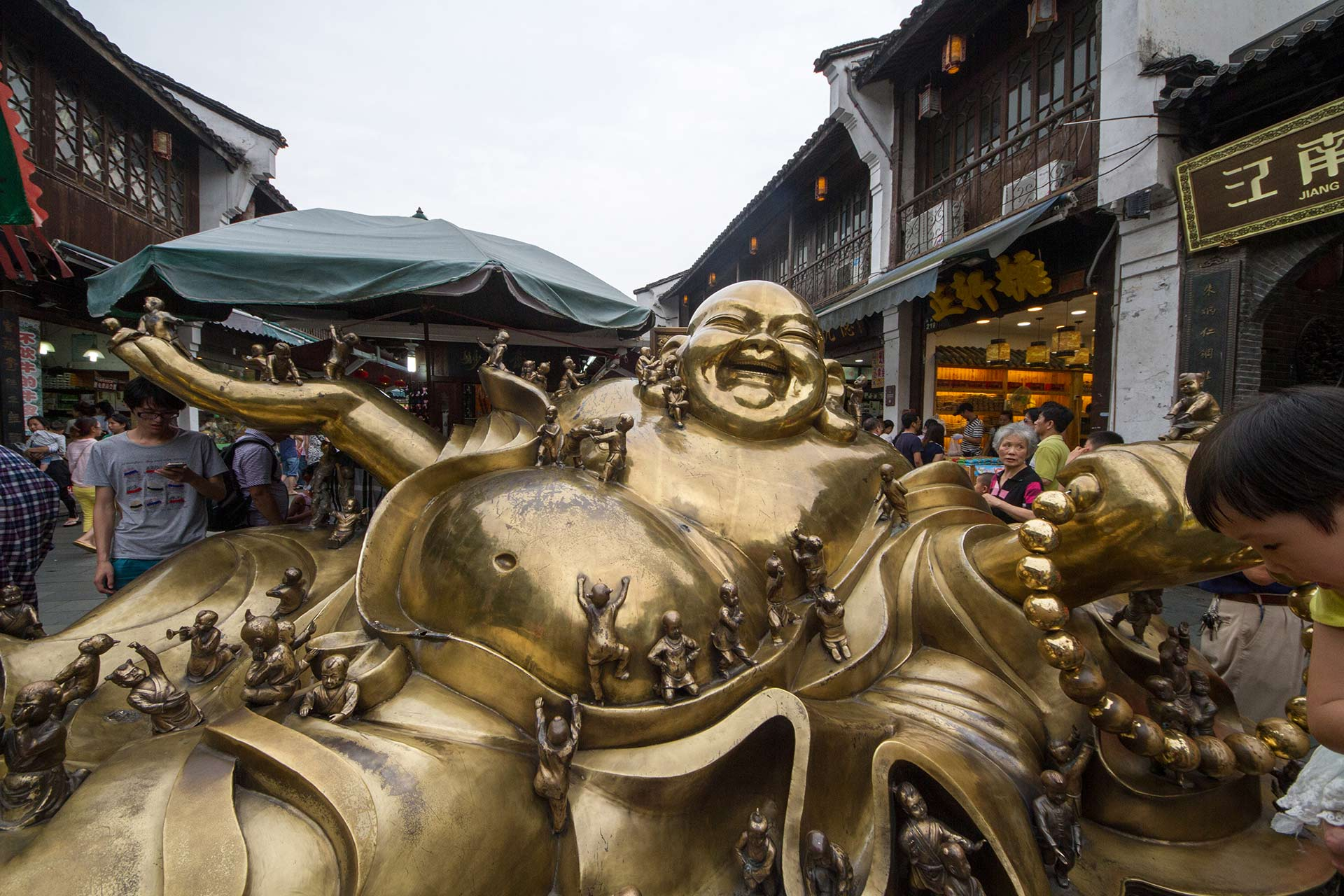 Brass statue of the Happy Buddha on Hefang Historical Street, Hangzhou, Zhejiang, China