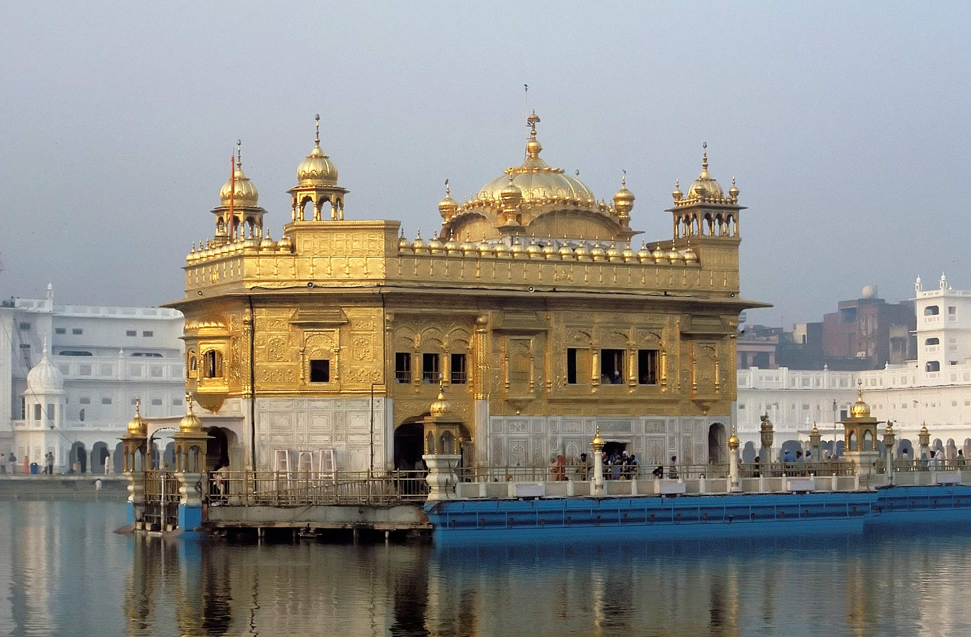 Hari Mandir Sahib (Golden Temple) with reflections in the Pool of Nectar, Amritsar, Punjab, India