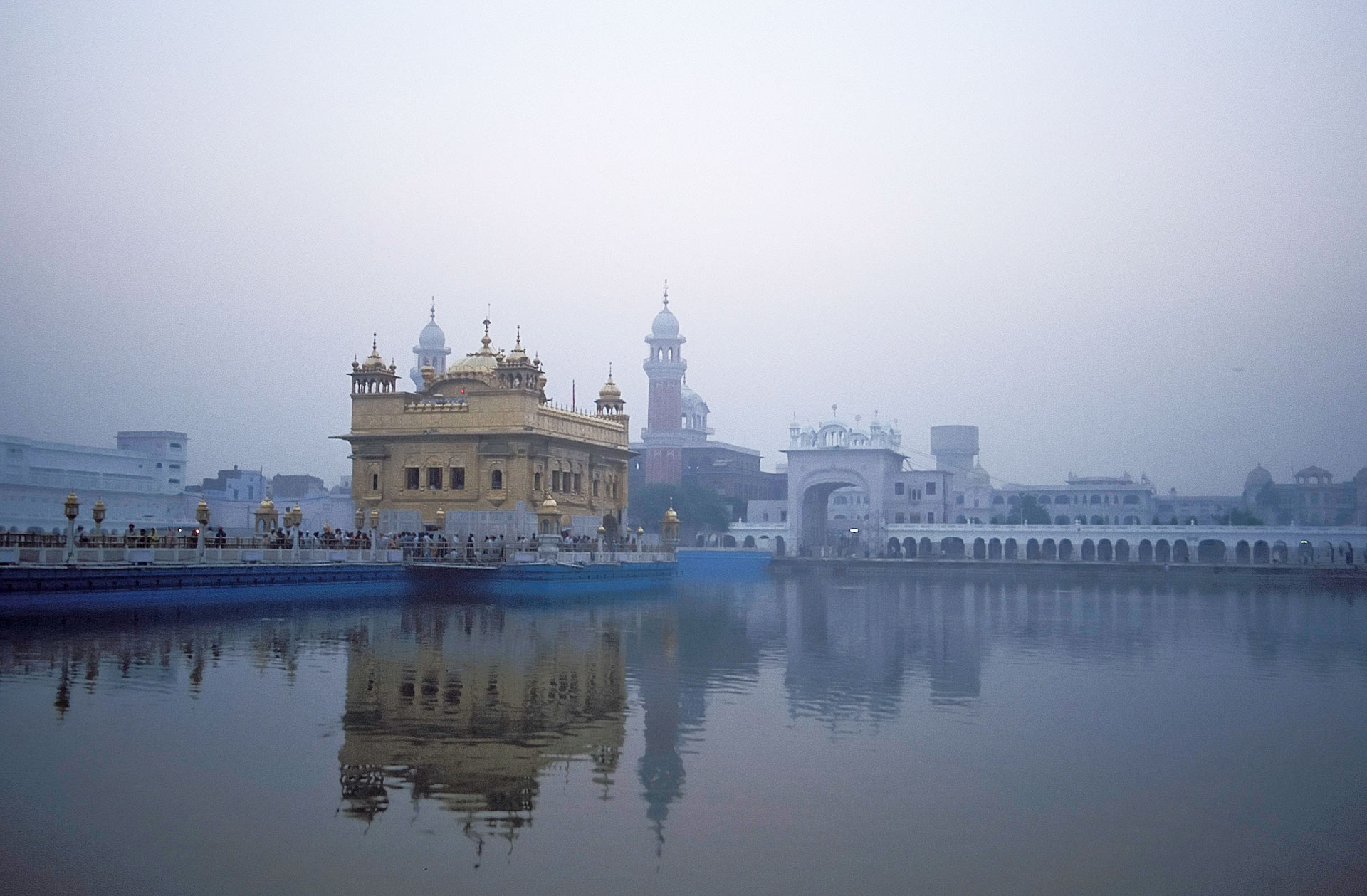 Hari Mandir Sahib (Golden Temple) with reflections in the Pool of Nectar at dawn, Amritsar, Punjab, India