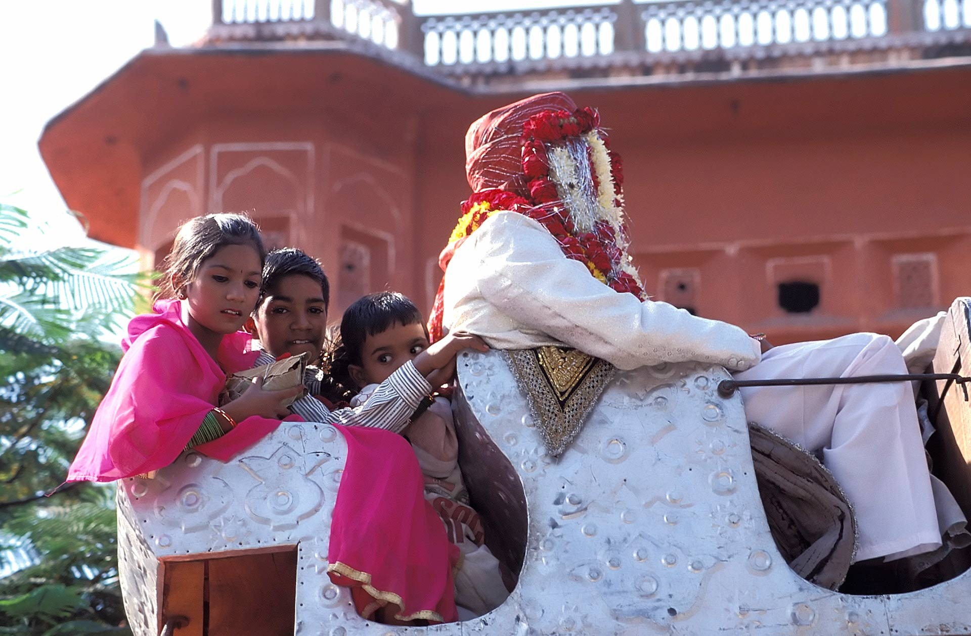Wedding procession by the Hawa Mahal (Palace of the Winds), Jaipur, Rajasthan, India