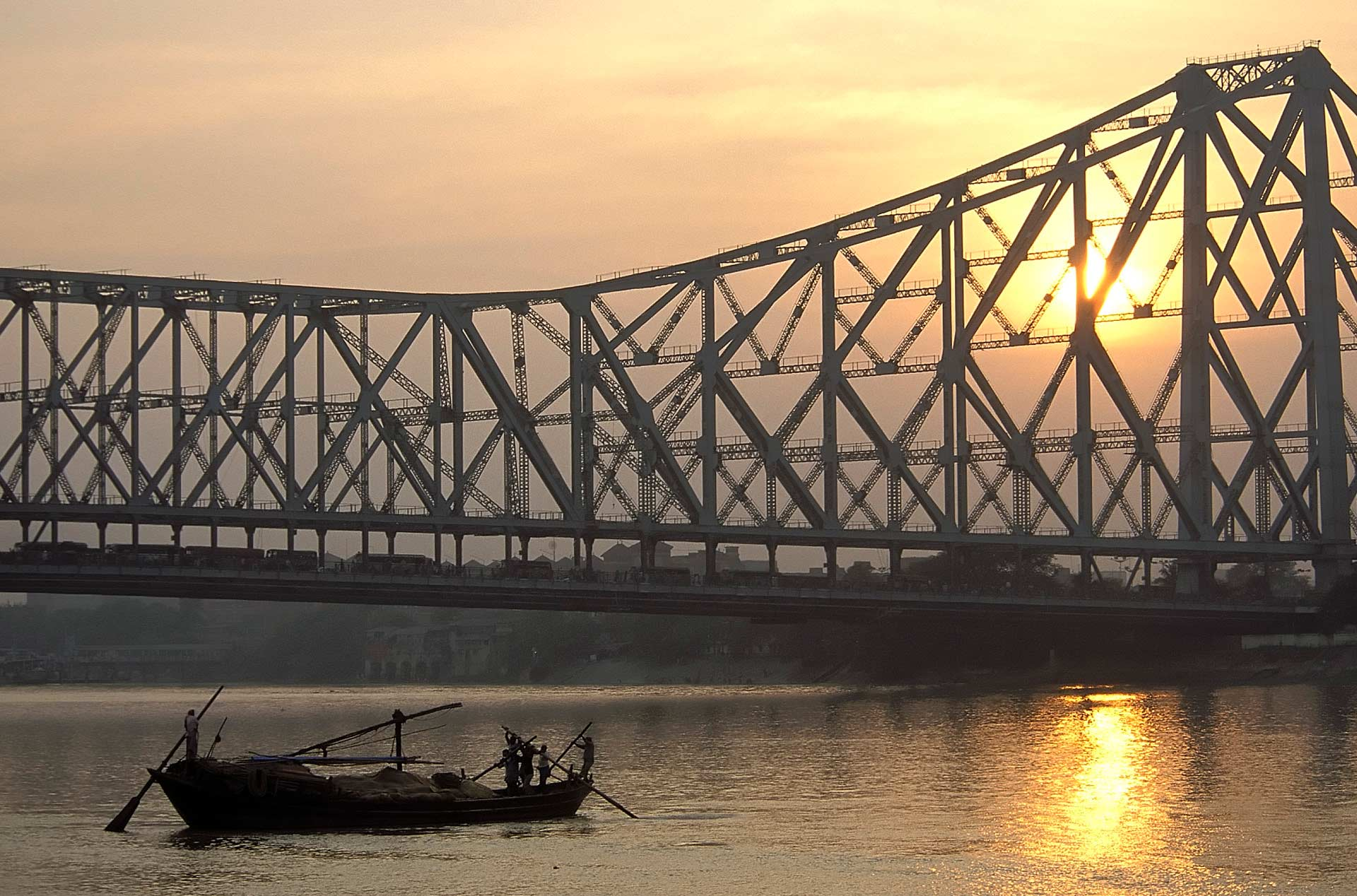 Howrah Bridge over the Hooghly River at sunset, Kolkata, West Bengal, India