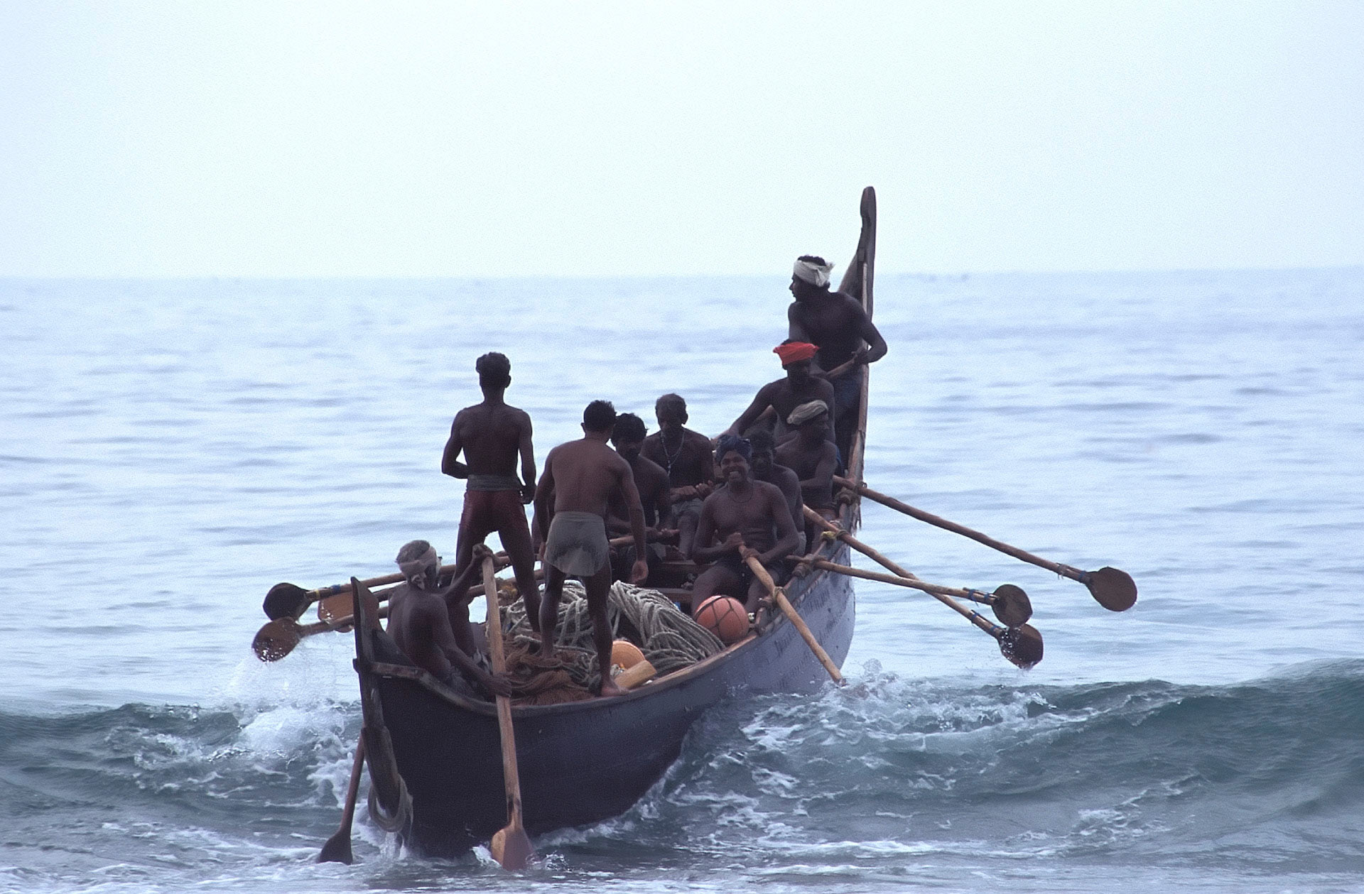 Fishermen in a boat on the Arabian Sea, Somatheeram Beach, Kerala, India