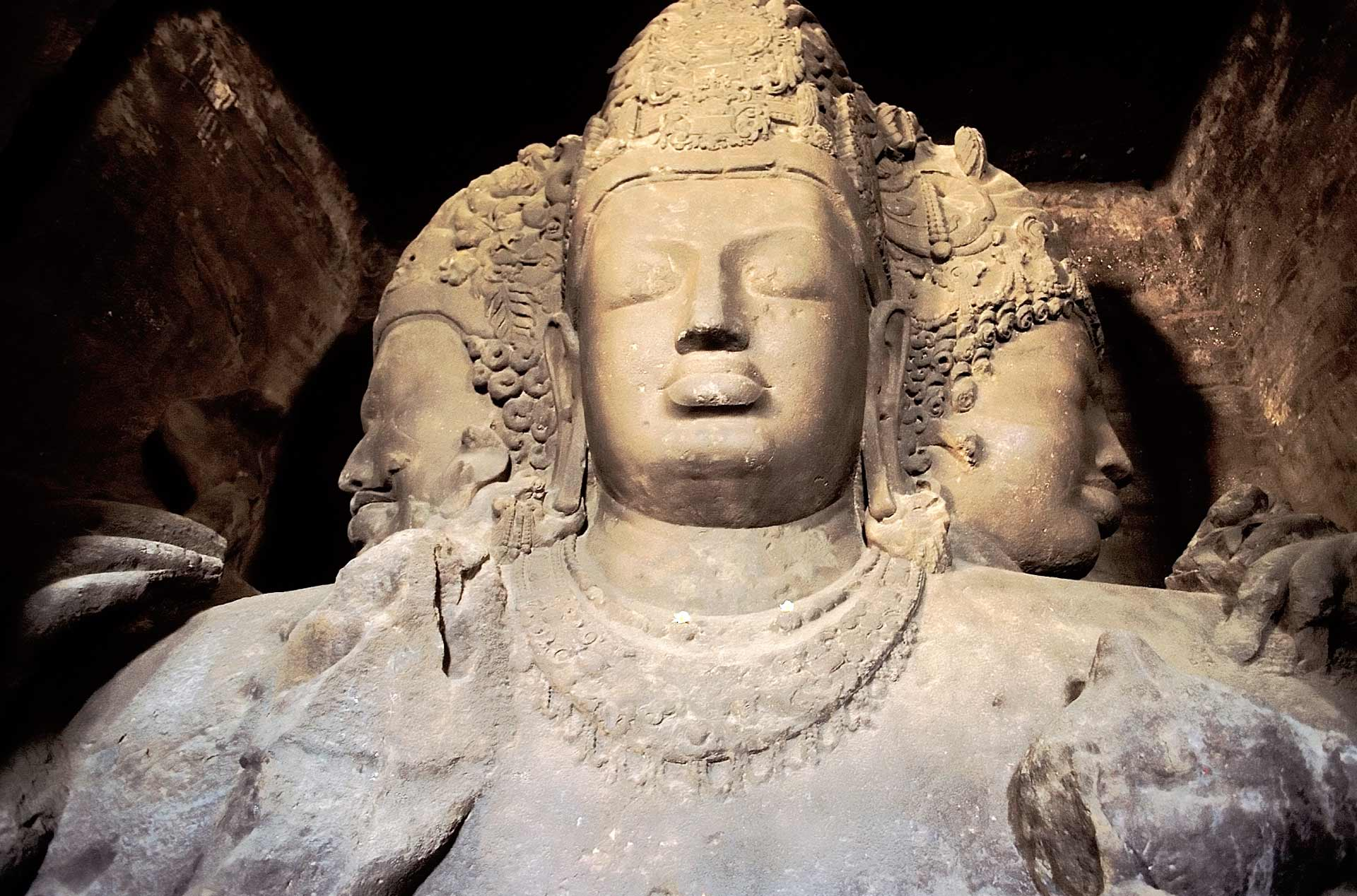 Mahadeva the three faces of Sadashiva sculpture at Elephanta Island, Maharashtra, India