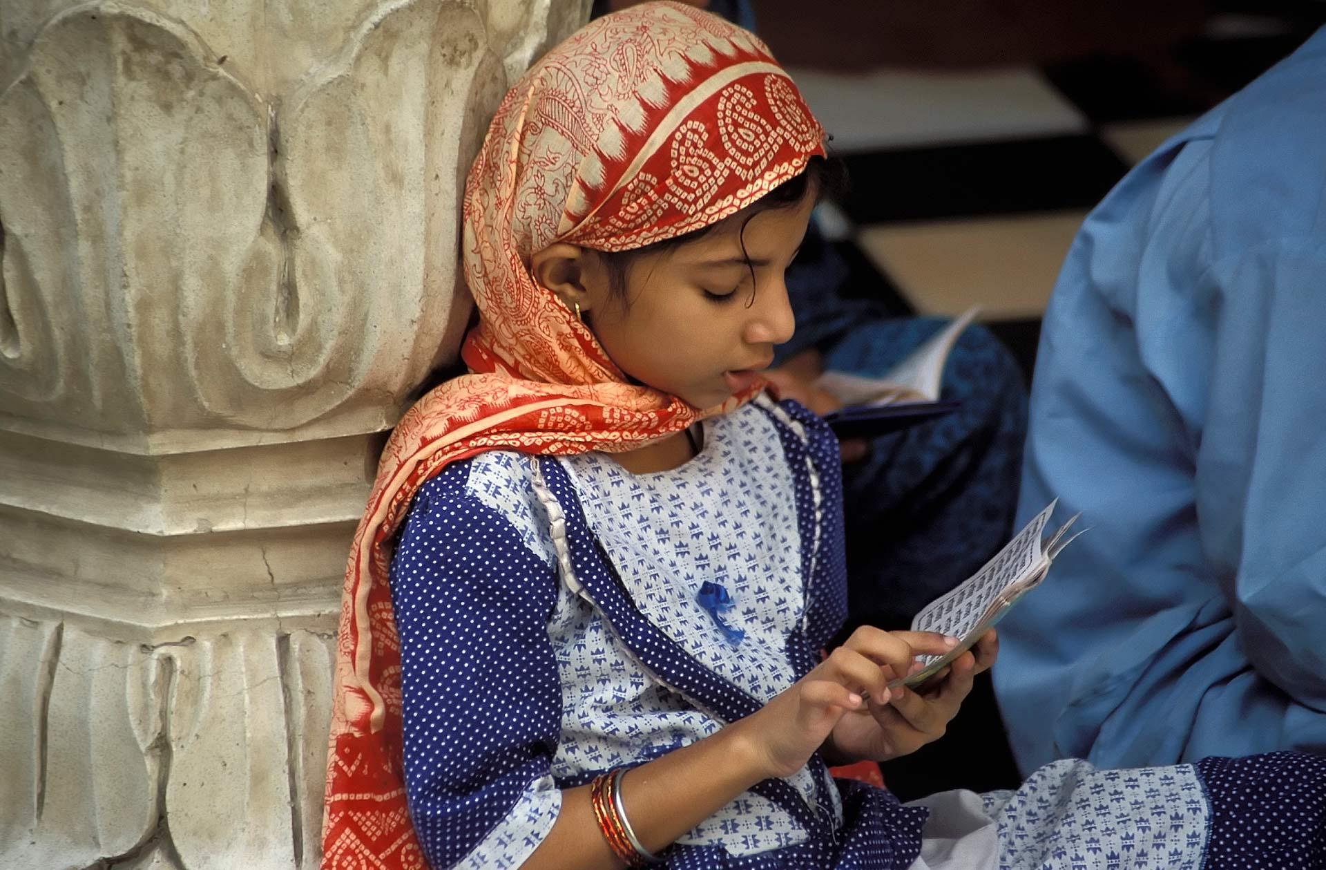 Sikh girl reading holy scriptures at the Gurdwara, Punjab, India