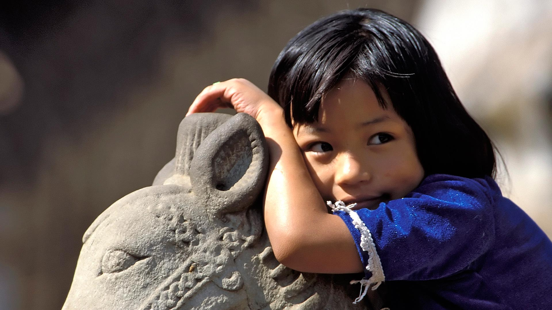 Girl sitting on a horse statue, Bhaktapur, Kathmandu Valley, Madhyamanchal (Central Region), Nepal