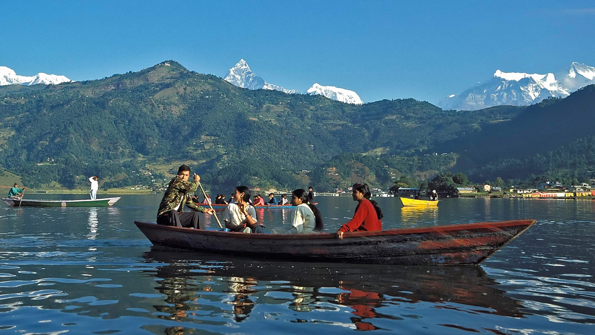 Boats in Phewa Lake, with the Annapurna Range in the background, Pokhara, Pashchimanchal (Western Region), Nepal