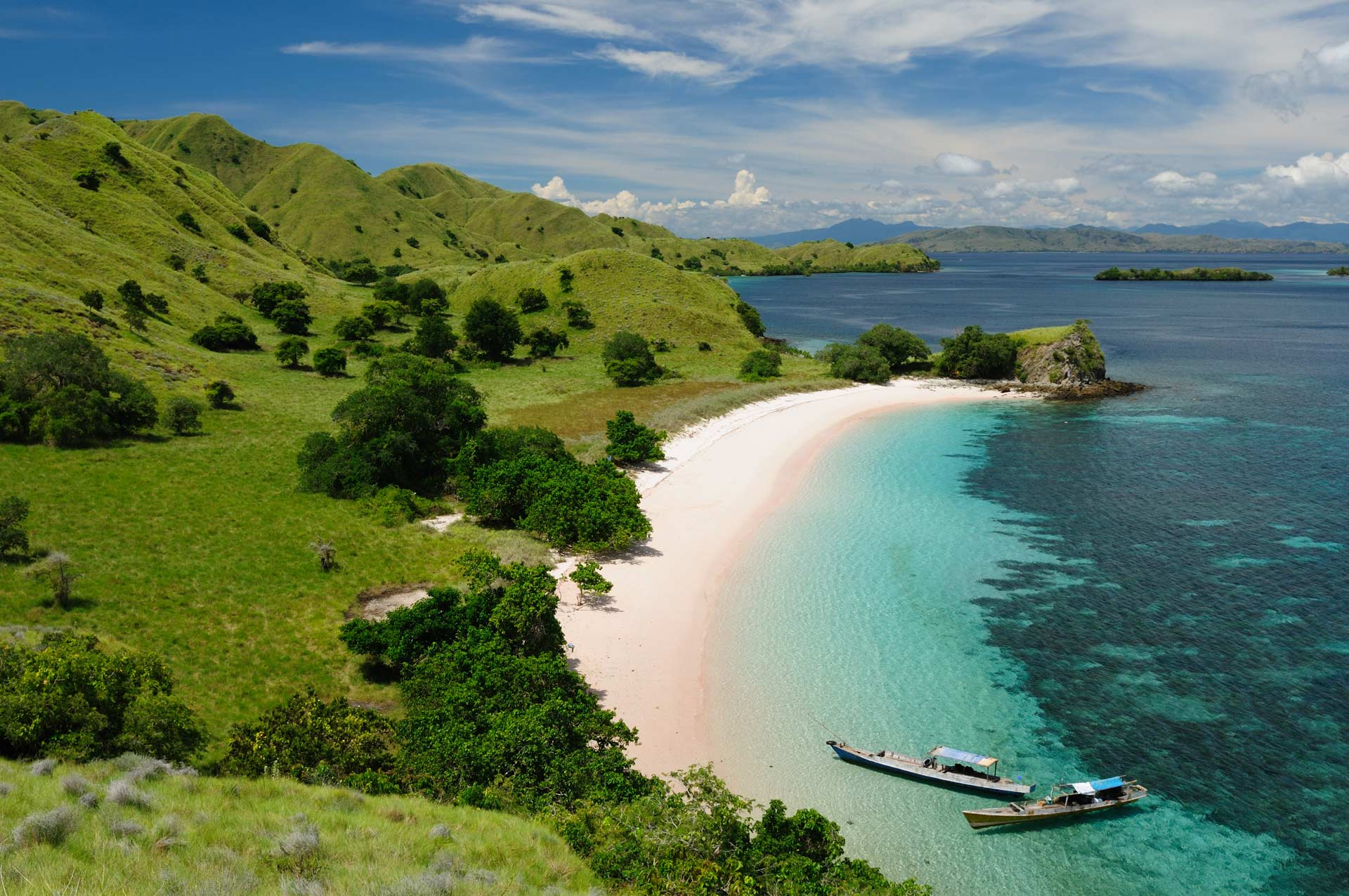 Beautiful Pink beach with pink sand and turquoise water in the national park on Komodo, Indonesia
