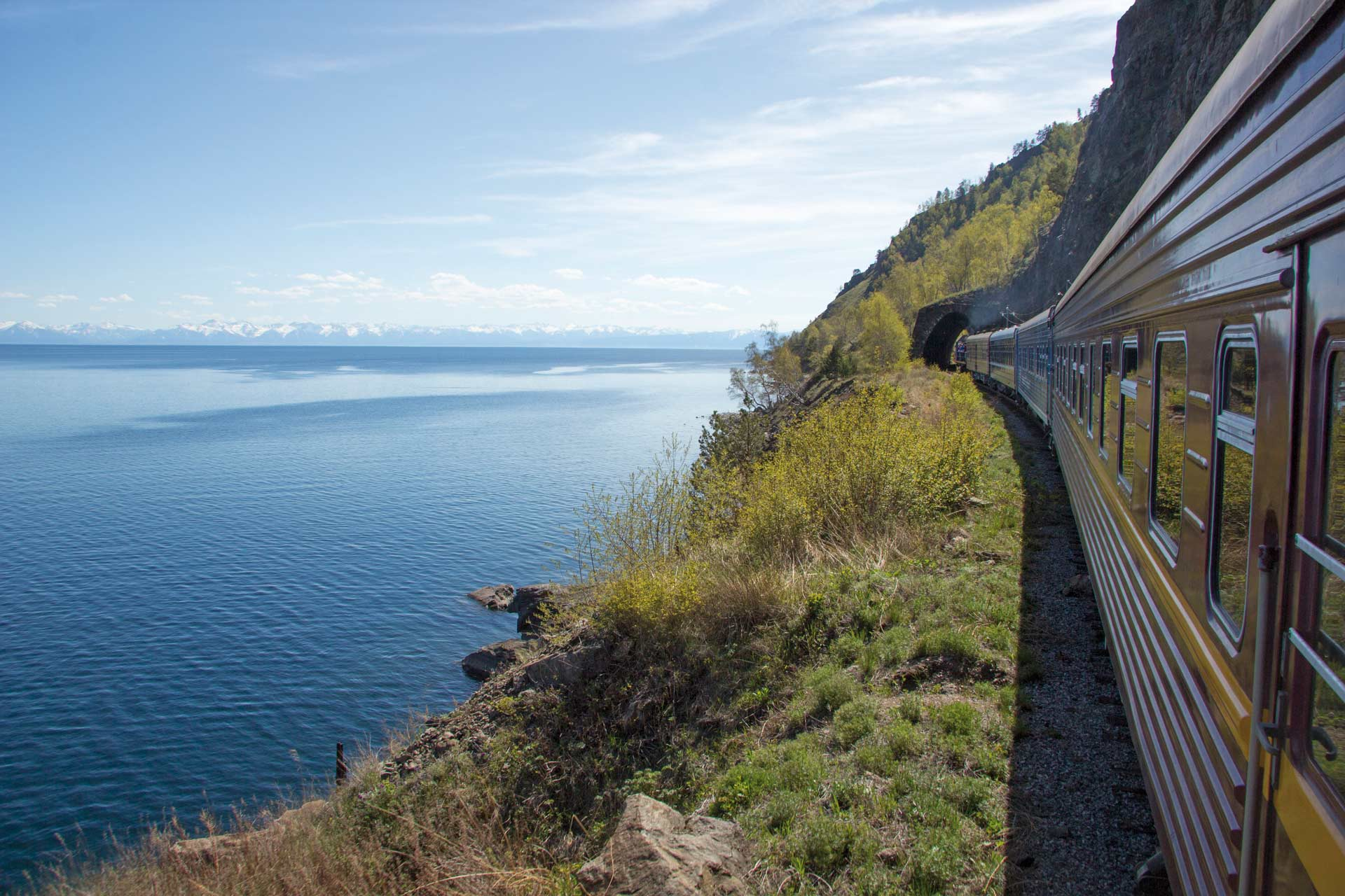 Trans-Siberian Railway, coast of Lake Baikal. Train movement along the lake shore