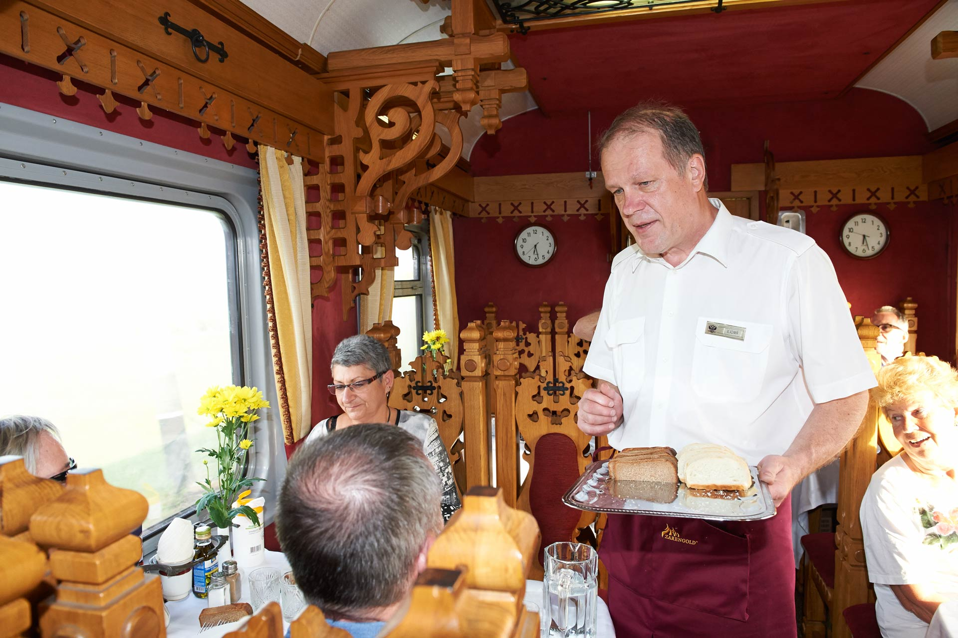 Male waiter serving the food at restaurant, Tsar's Gold Private Train