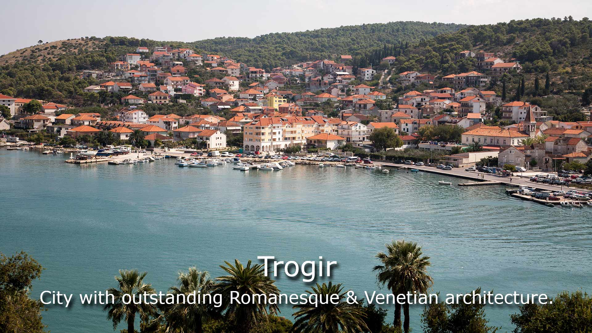 View of sea coast in Trogir town with colorful houses, Dalmatia, Croatia